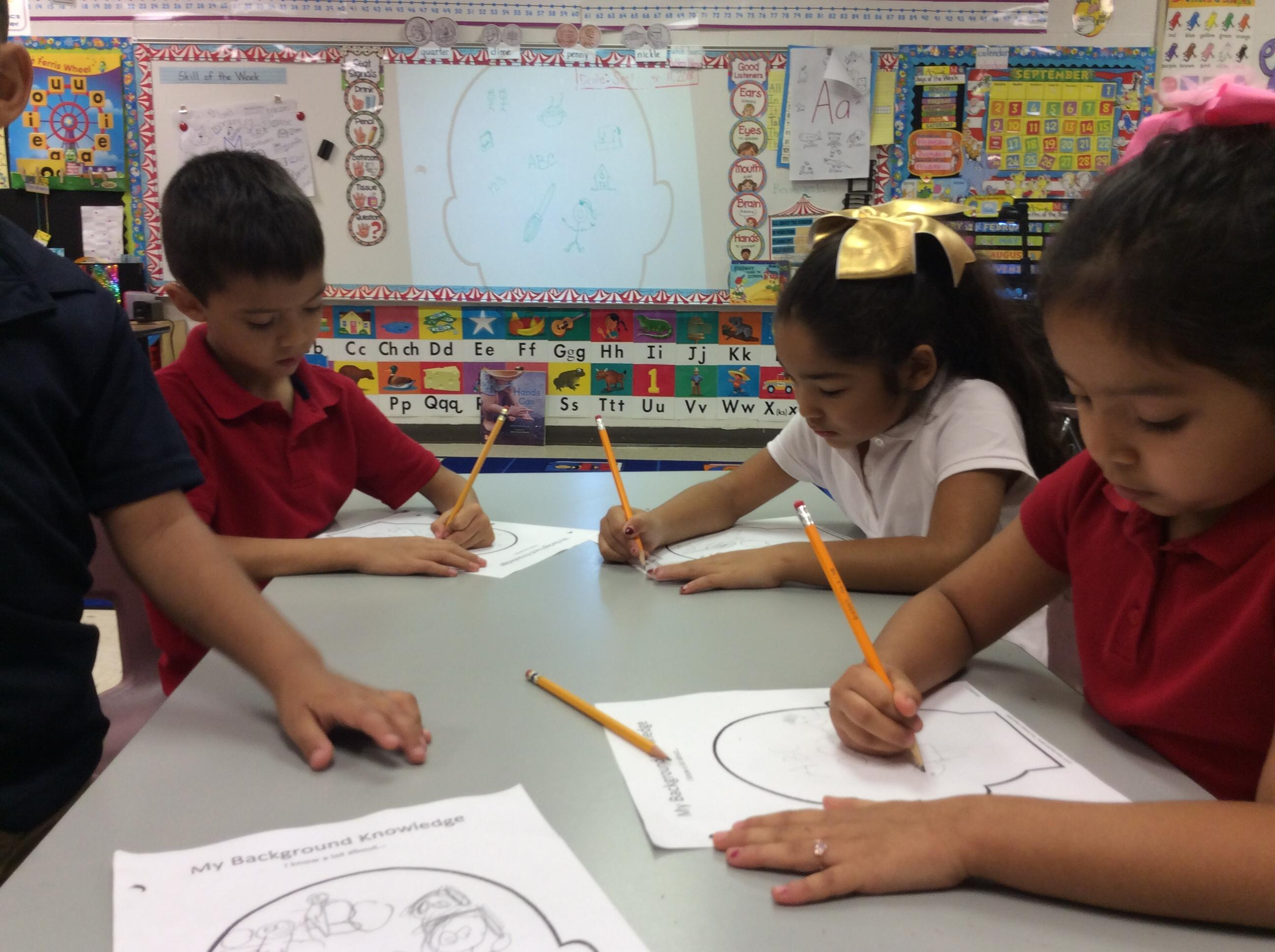 kinder students working