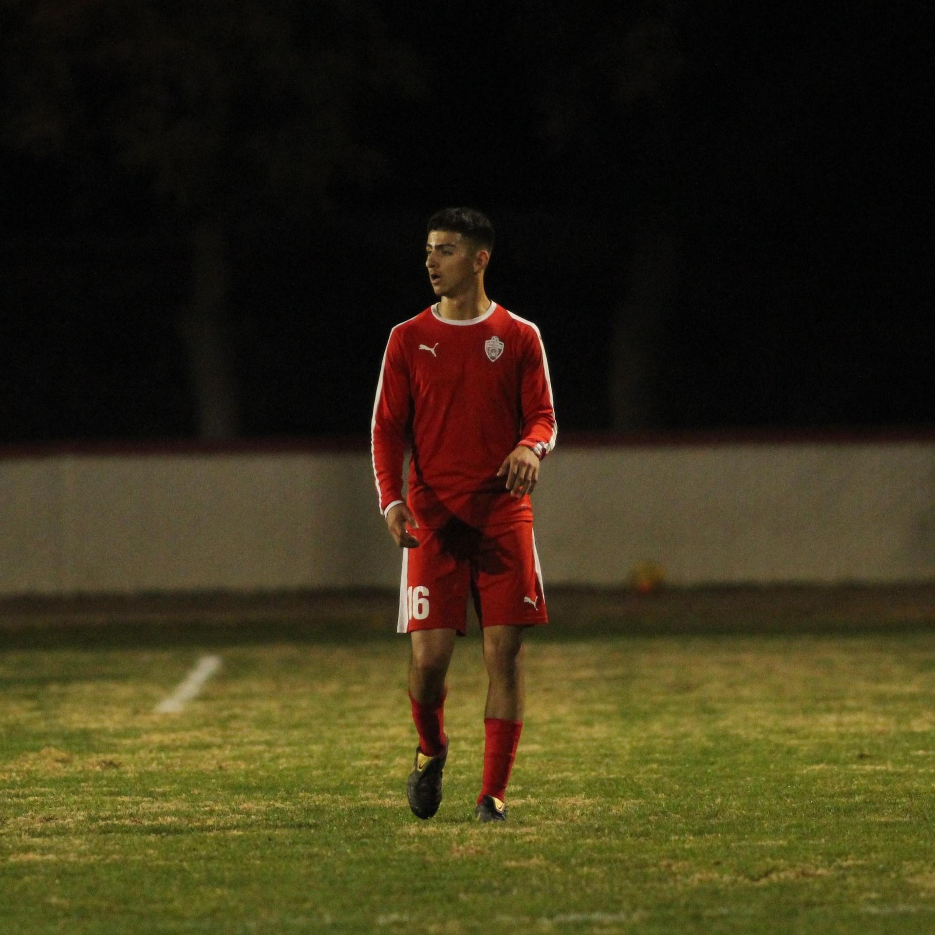 Christian Fernandez looking down the field