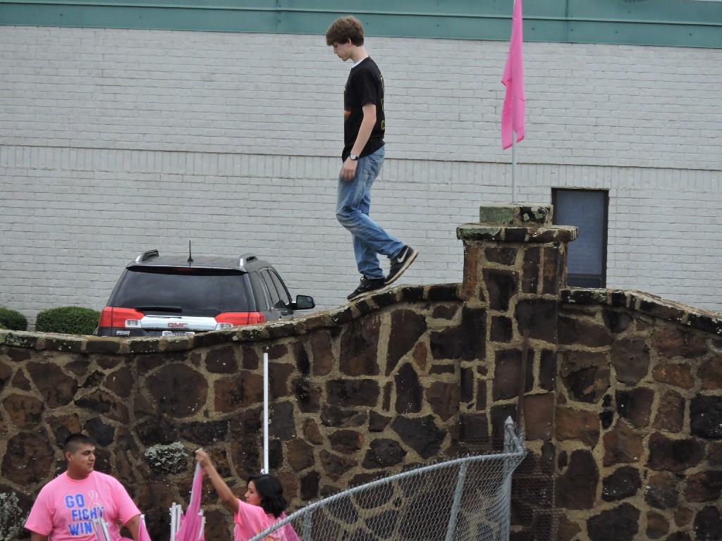 placing flags on the rock wall