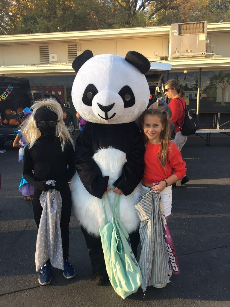 three children at Trunk or Treat event