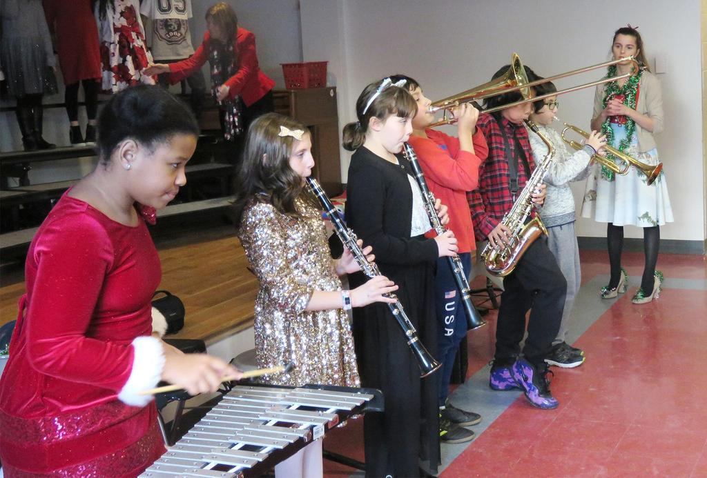 The fifth-grade band, featuring five members on different instruments