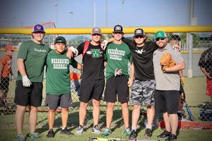 6 guys pose together outside in baseball hats