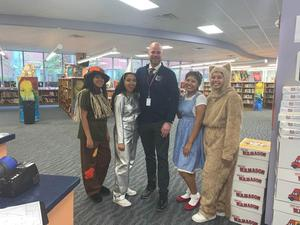 Mr. Lewis with the students dressed as the Wizard of Oz