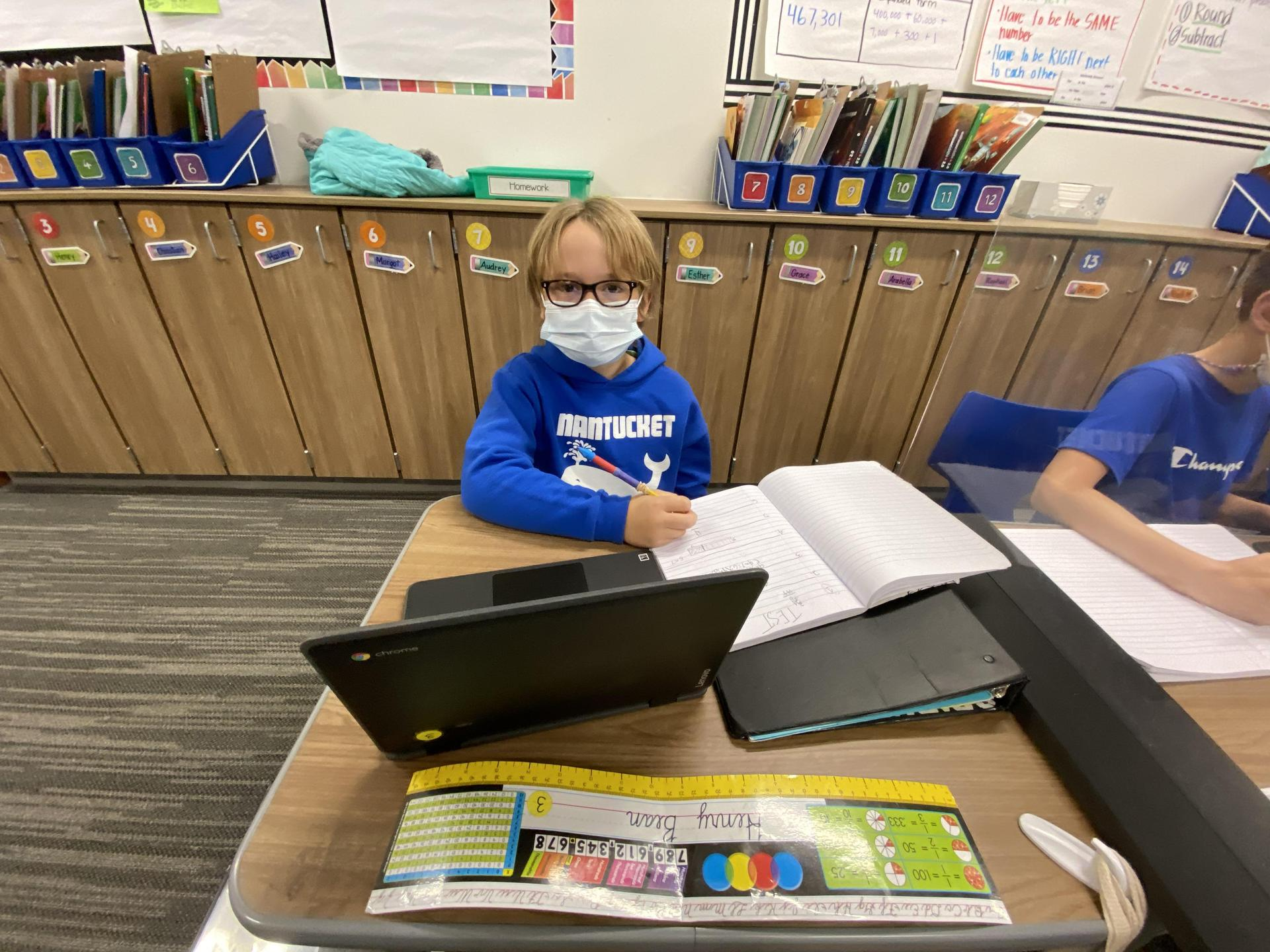 Student learning on a chromebook.