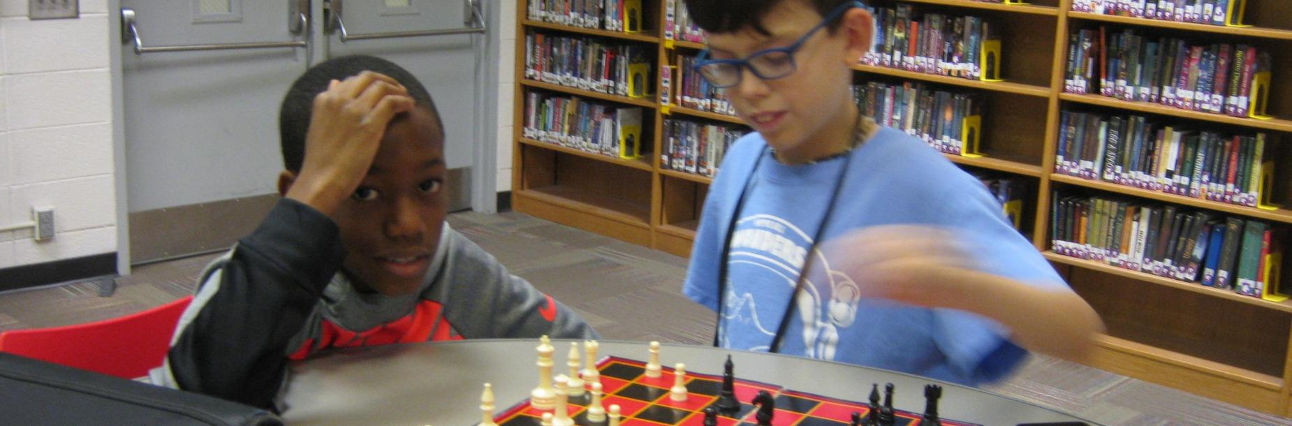 Students playing chess in the learning commons makerspace