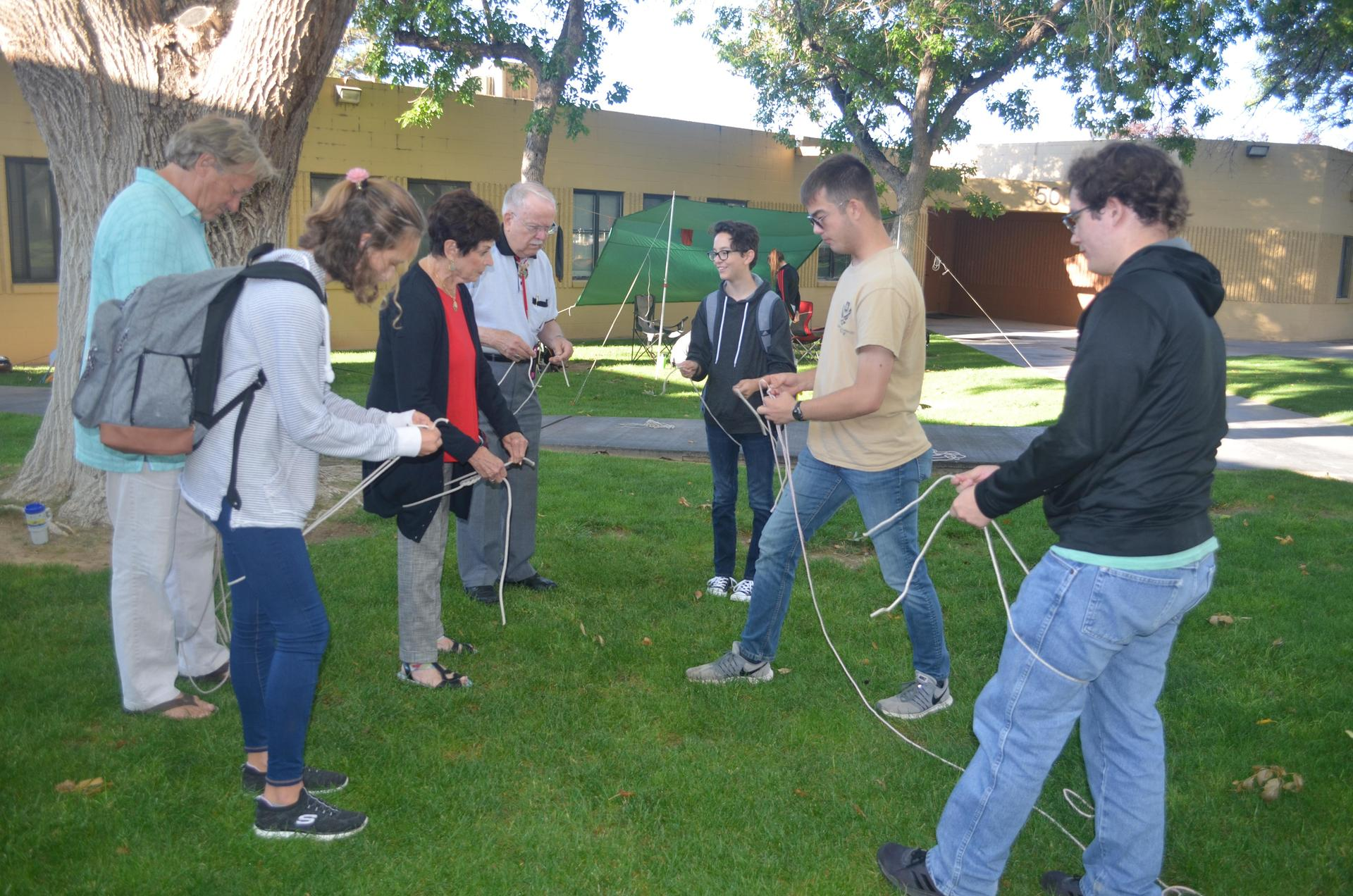 Students and parents work on Outdoor Leadership Program project