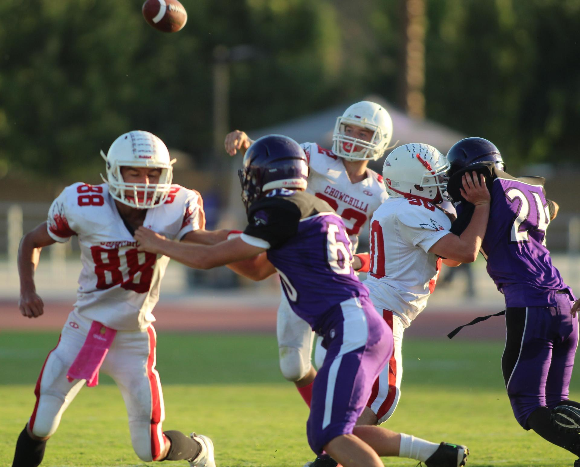 JV Football players in action against Washington Union