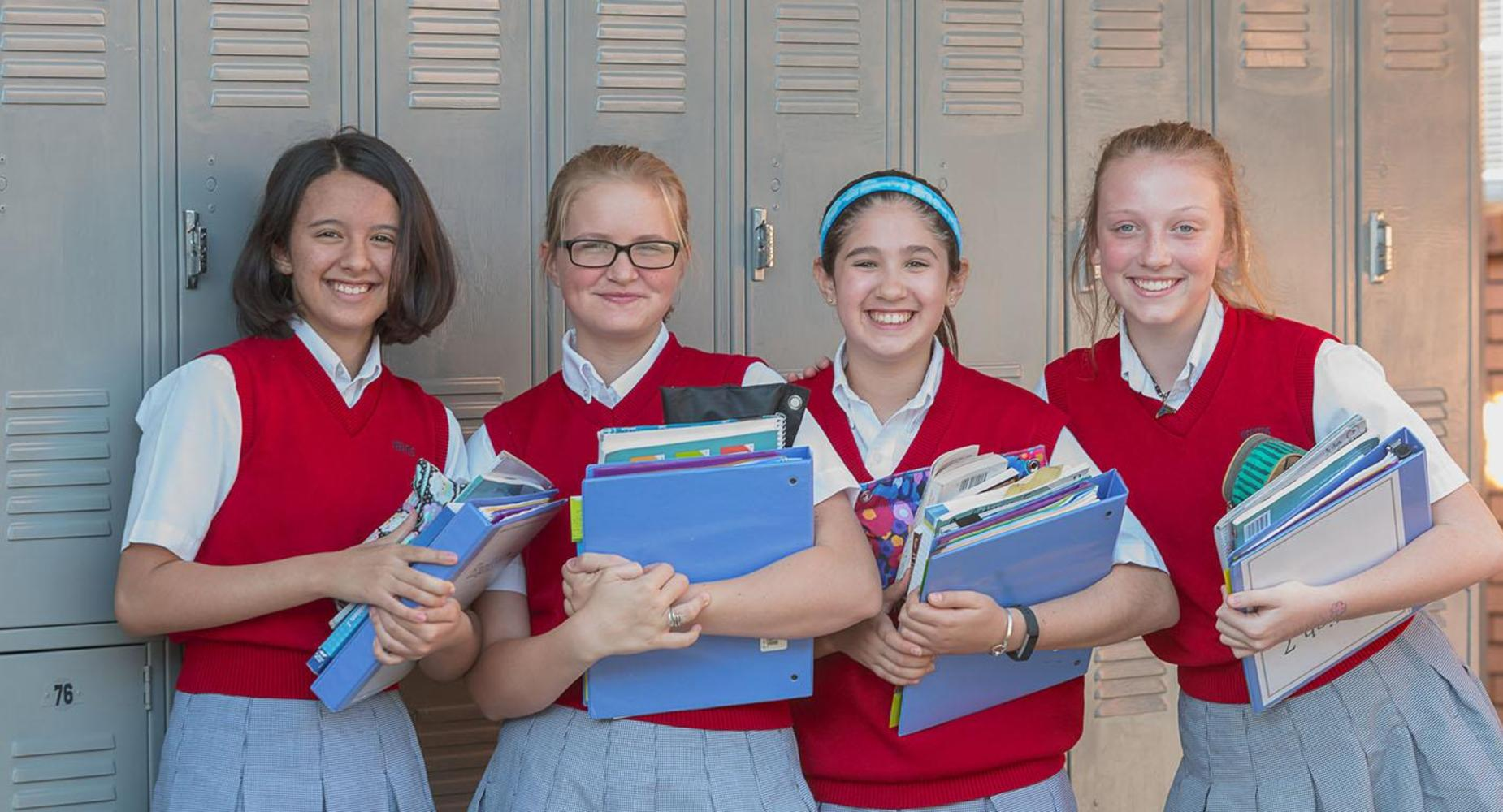 Group of students pose in front of their lockers