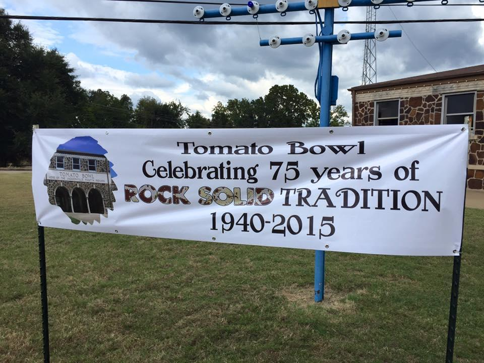 banner in front of tomato bowl celebrating 75 years of play