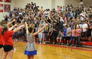 Students in gym at an assembly