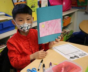 Photo of Franklin 2nd grader participating in China Day activities, part of a 2nd grade unit on cultural diversity.