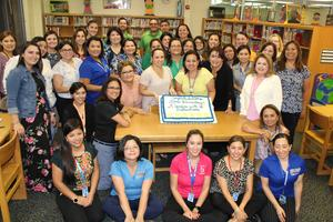 mims staff with superintendent and cake