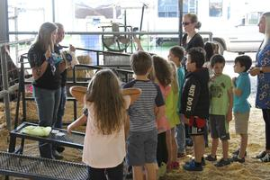 JSE students watch as FFA offciers give livestock presentation