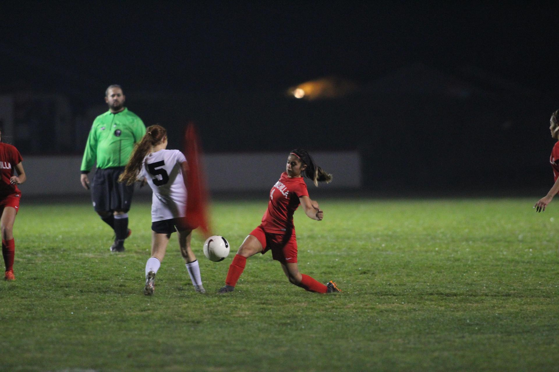 Girls playing soccer against Merced.