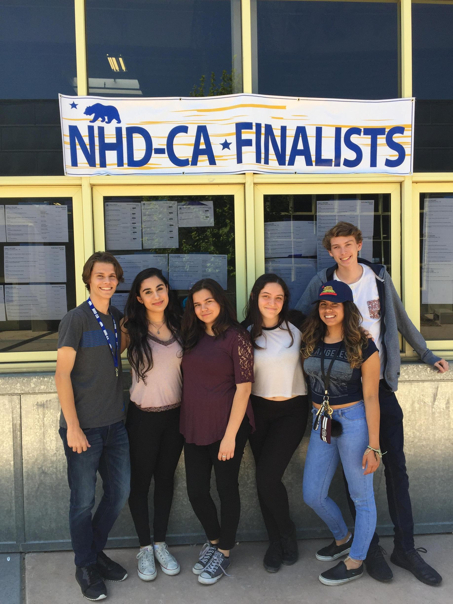 Group of students in front NHD CA Finalist sign