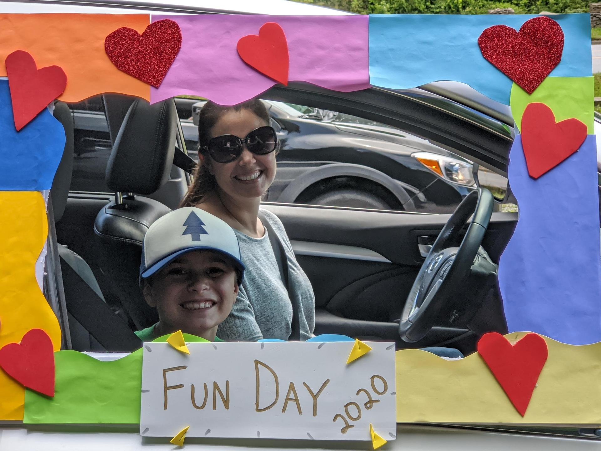 Parent and student drive up on fun day for a photo booth