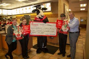 chick fil a scholarship recipients pose for a photo