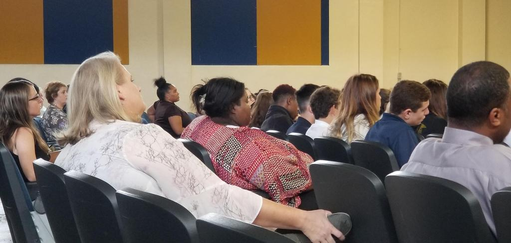 students and faculty in auditorium