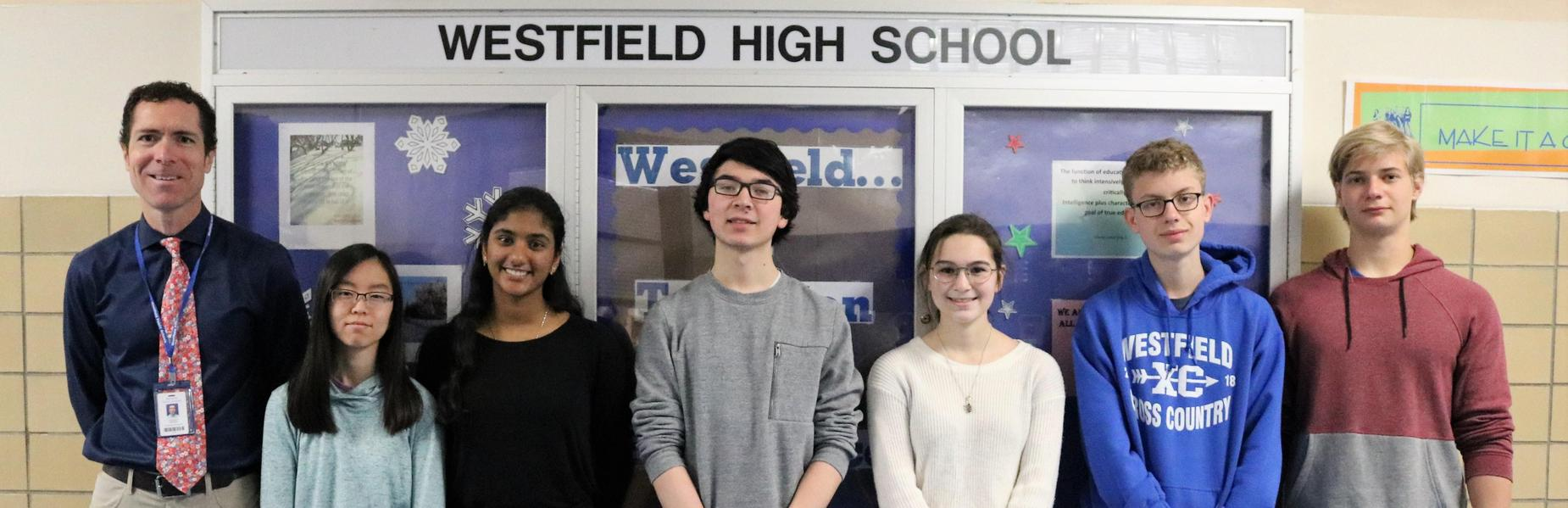 Photo of 6 Westfield High School juniors who earned perfect scores on portions of recent SAT & ACT. Pictured here with assistant principal Warren Hynes.