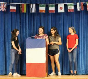 Members of the Westfield High School French Club give a presentation on French culture, history and tradition at the Third Annual Night of Celebration: The Cultural Identity of WHS on May 2.  From left, Katherine Ceraso, Lauren Sullivan, Kayla Butera, and Katherine Hamilton.