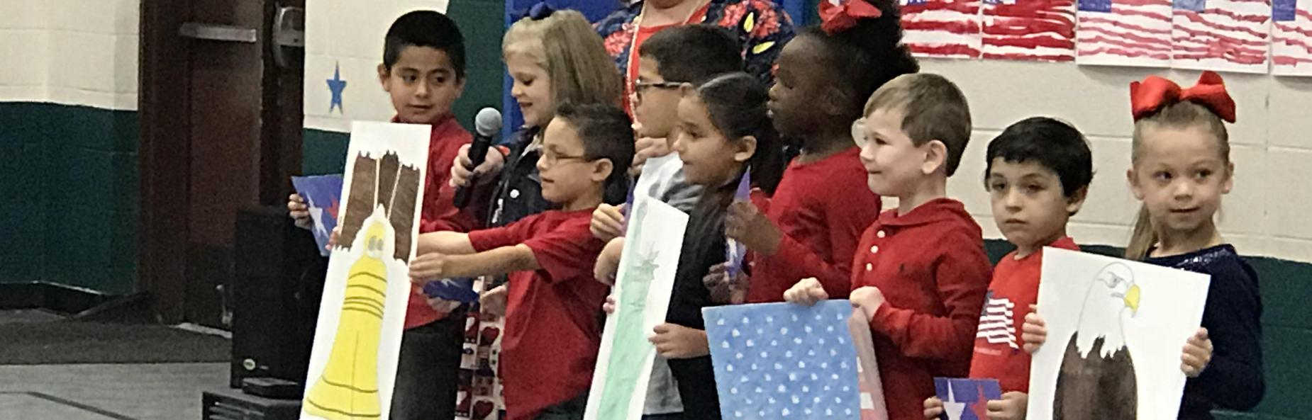 children holding patriotic posters