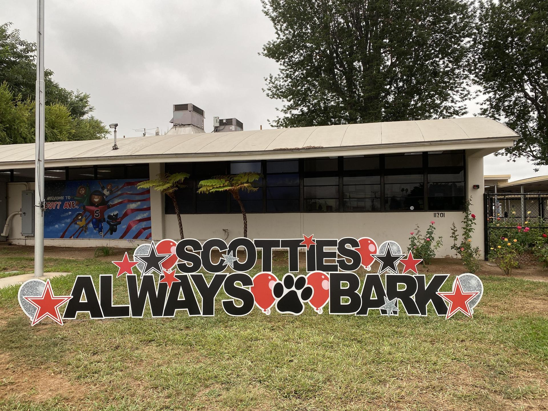 Image of front of Scott Avenue with lawn sign 'Scotties Always BARK'.