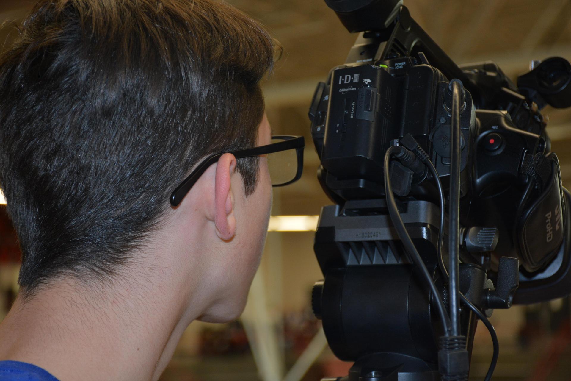media student behind a camera