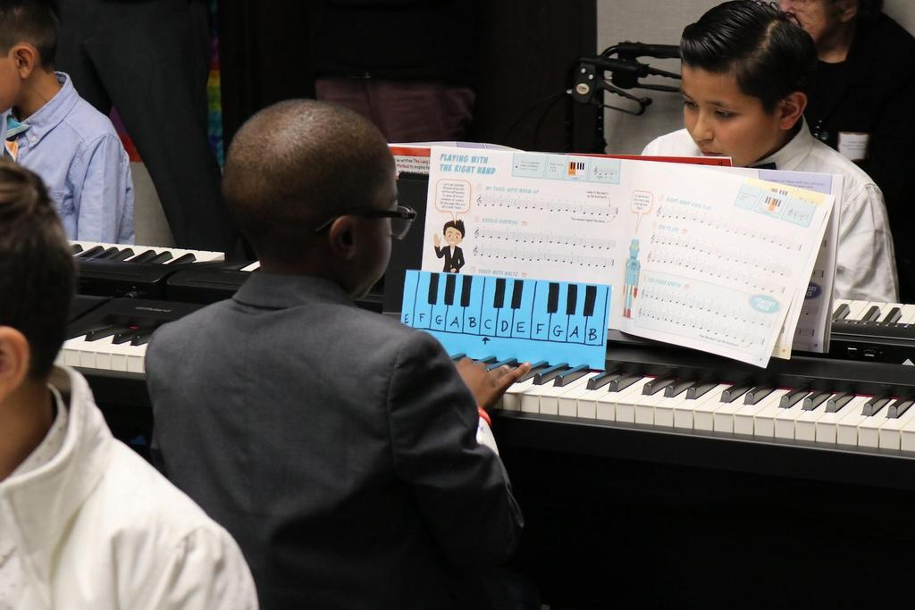 Magnolia Student Playing the Piano