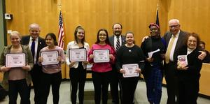 6 female student essay contest winners posing with their certificates and 4 members of B3T - Building a Better Bensalem Together