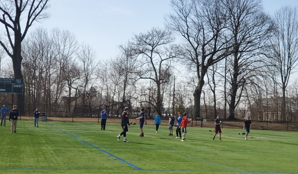 Students playing on sports turf fields.