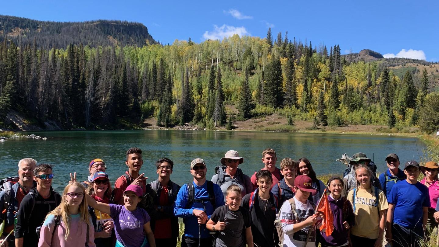 Group of students and teachers in front of lake