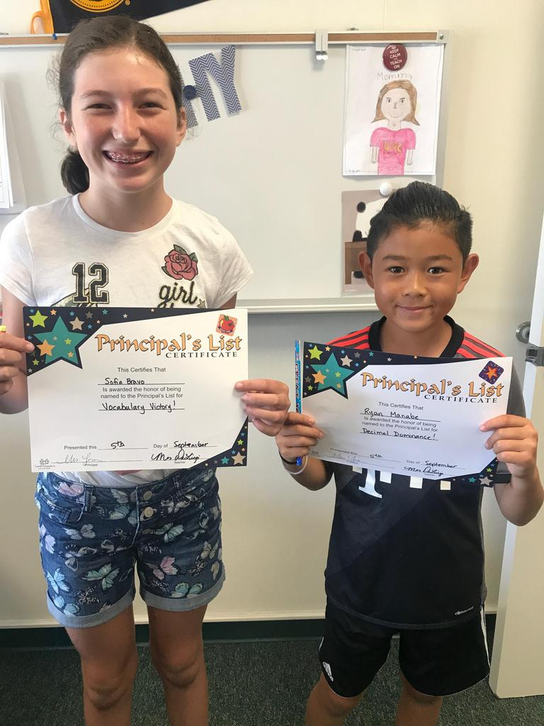 Two students receiving a Principal's award