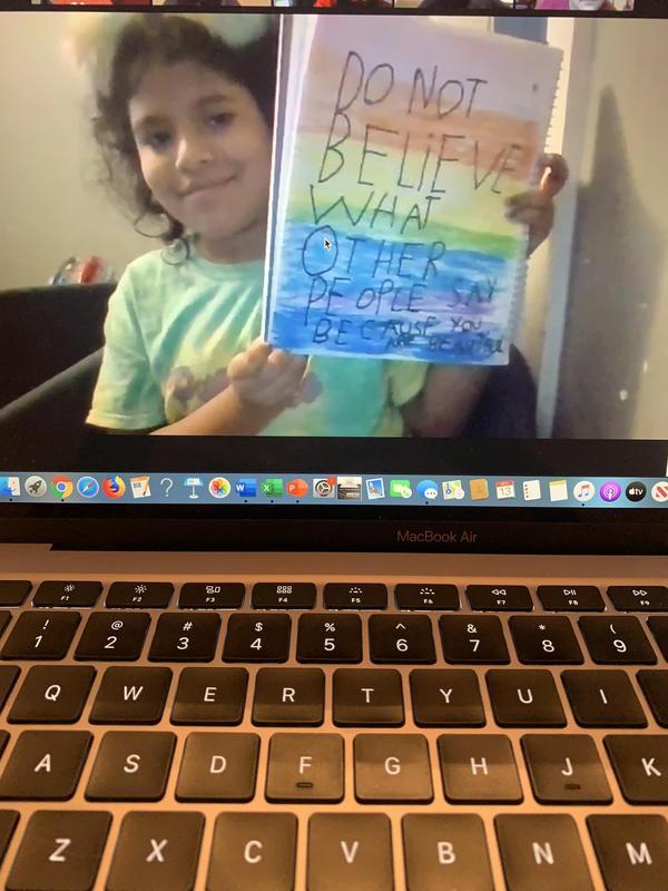 Alyssa holding her drawing