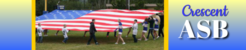 Students Holding Flag on Football Field