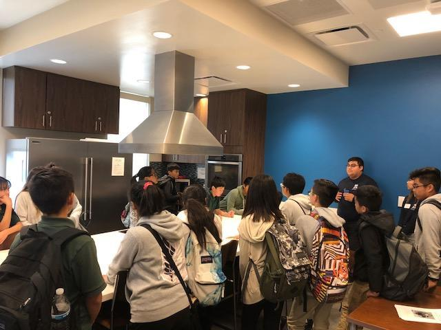 CCA students touring a kitchen at a SJSU dormitory.
