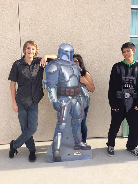 Students posing in front of Boba Fett
