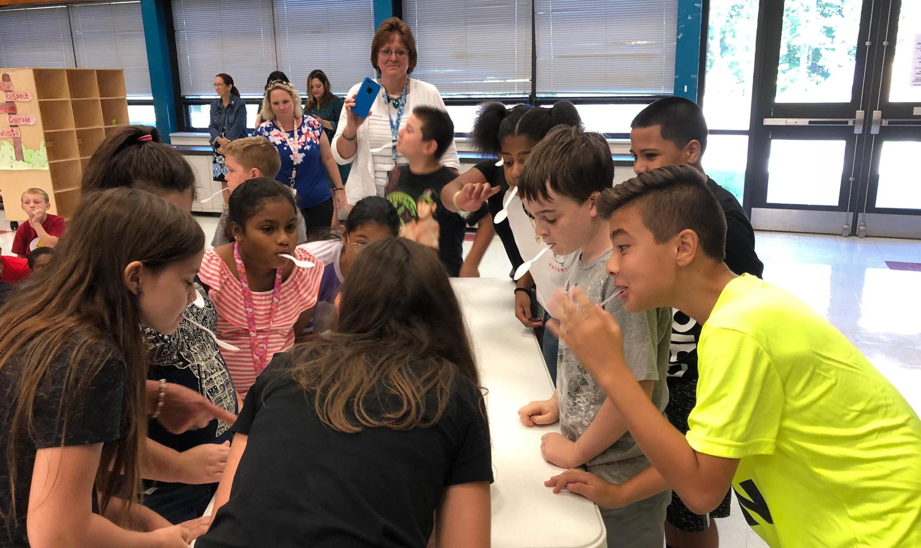 11 elementary school students showing what they know in a game show style event at the School-Wide Positive Behavior Supports assembly.