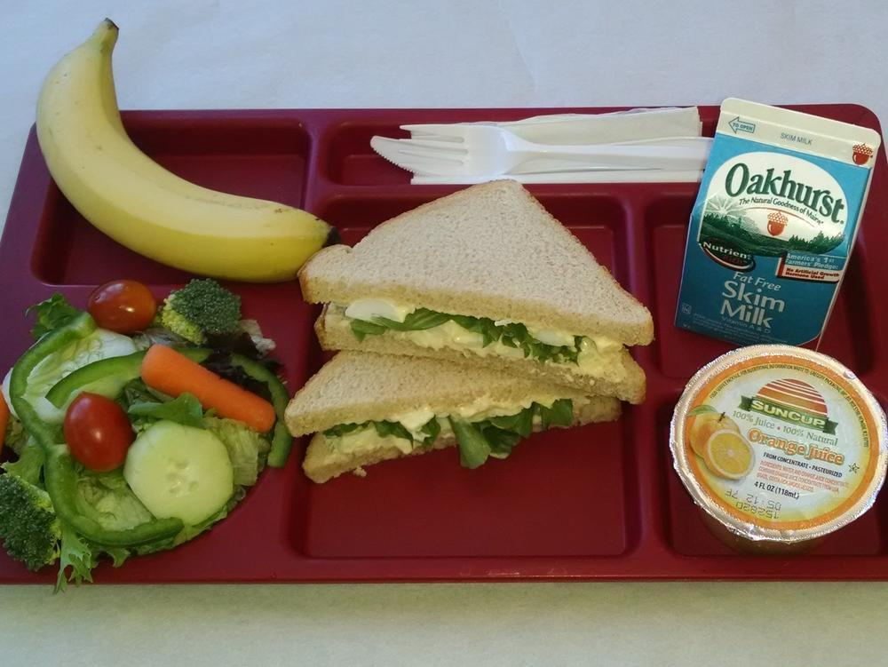 Egg Salad Sandwich, Salad, Banana, 100% Juice and Milk