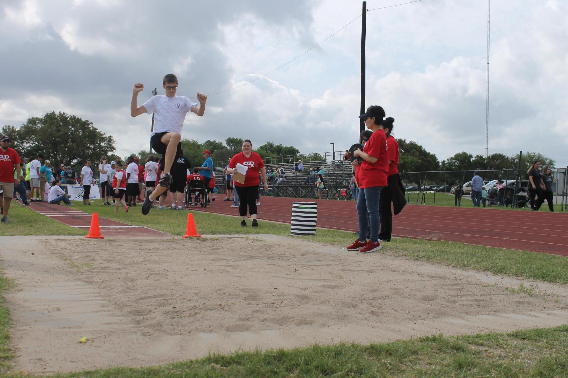 student participating in the long jump