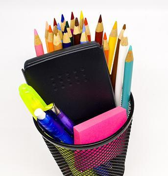 pencil holder stuffed with colored pencils, calculator, etc
