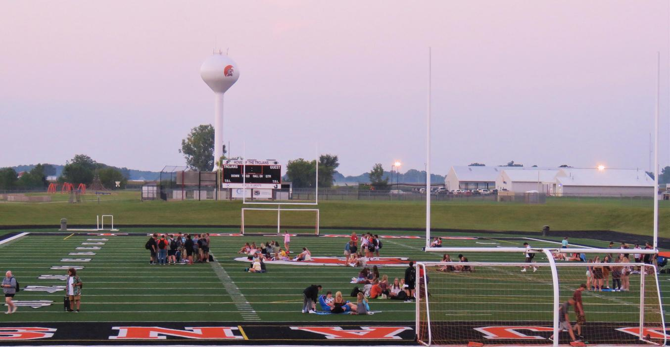 Seniors gather to watch the sun rise on their last first day of high school.