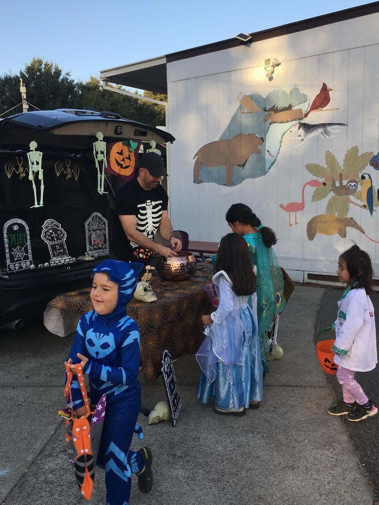 children going to trunk to get candy