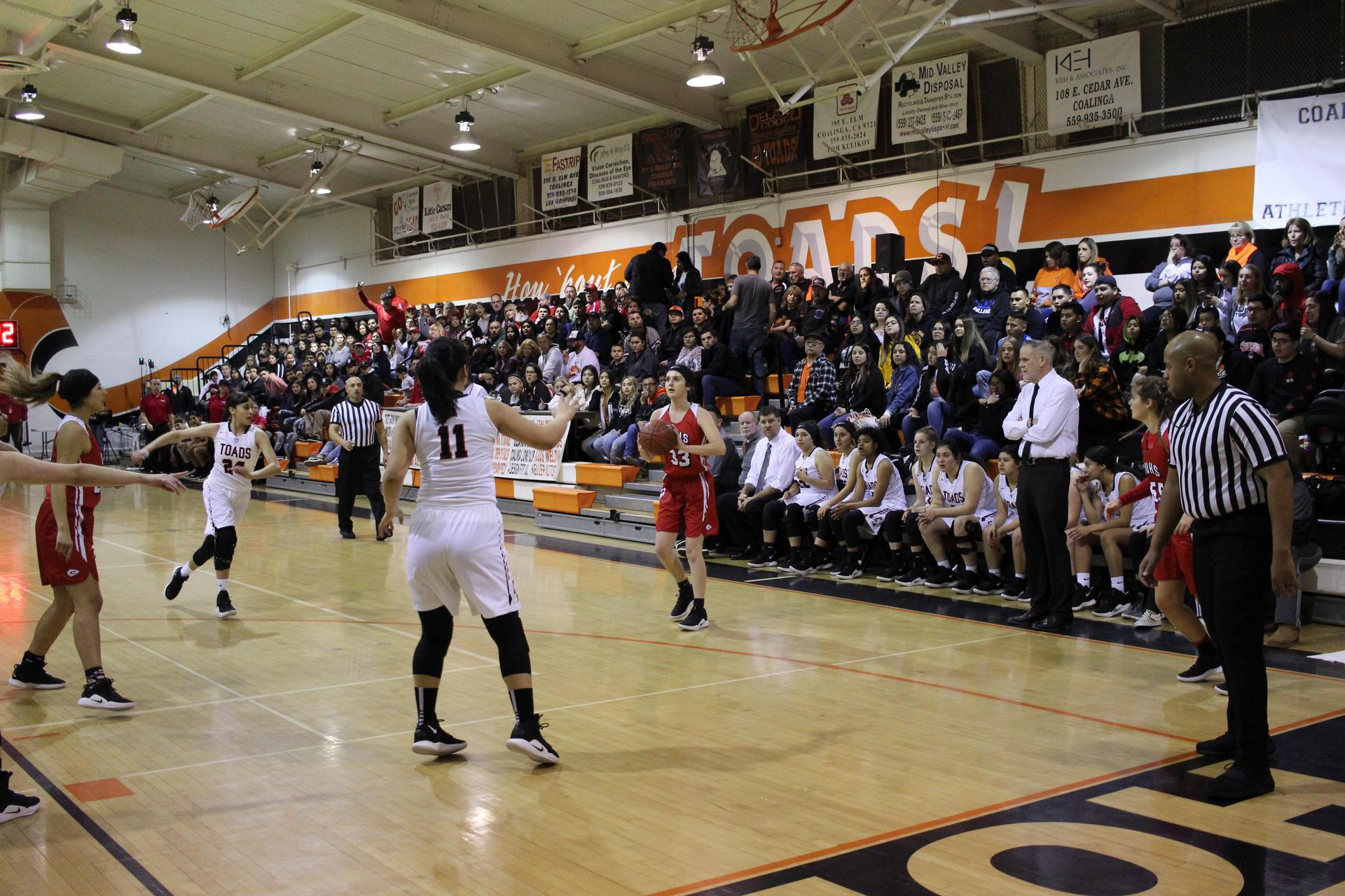 Varsity Girls playing basketball against Coalinga