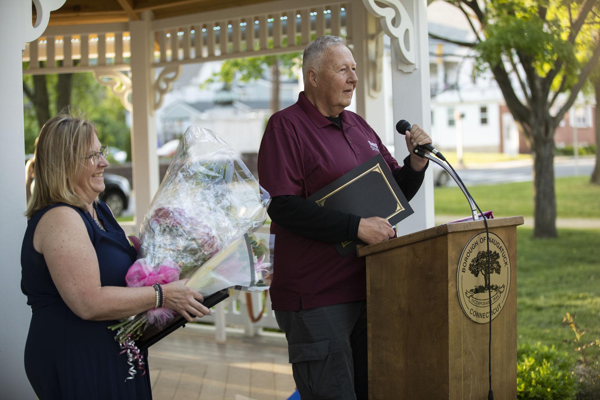 Mayor Pete Hess congratulating Jill Mahoney