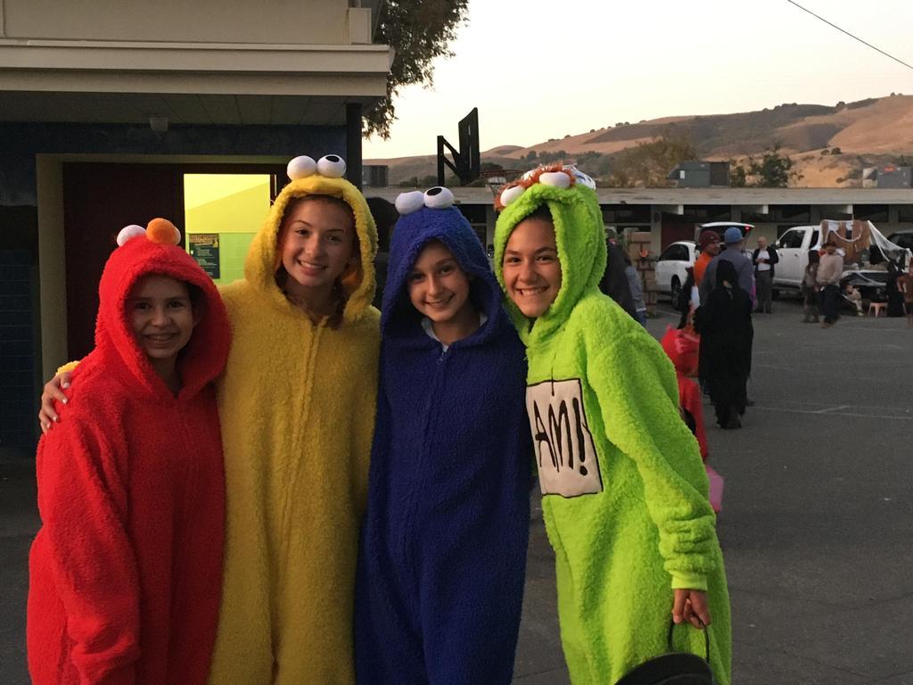 kids dressed as sesame street characters