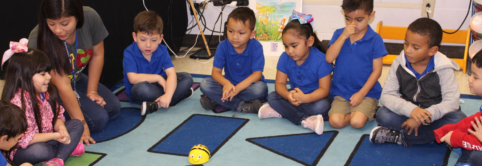 teacher and students using robot
