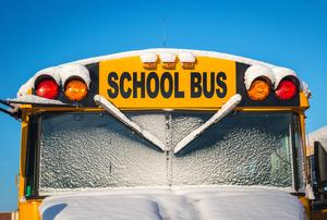 Front of a bus with snow.