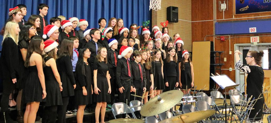 """Photo of Roosevelt Intermediate School's """"Sharps and Flats"""" choral group performing at Washington School."""