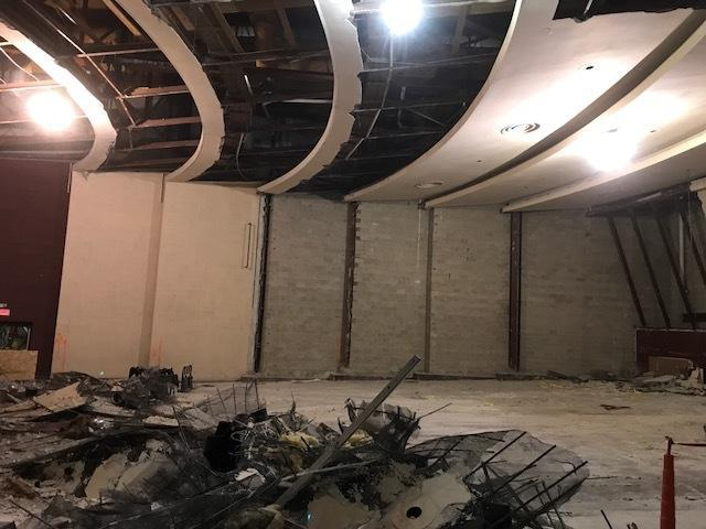 "DemPlaster is down, leaving block wall.  The ""scalloped"" walls in the existing auditorium weaken acoustics. Construction will replace the scallops with a smooth wall for better transmission of sound.   olition"