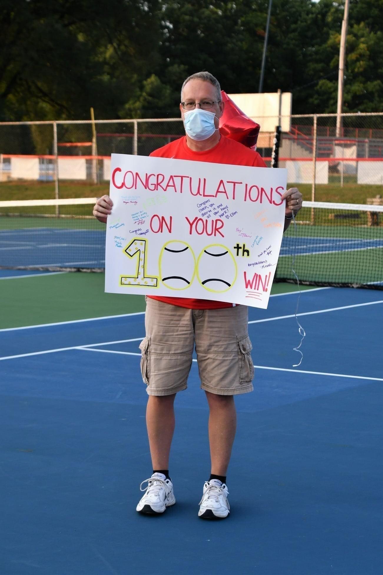 Tennis Head Coach John Riley gets his 100th career victory